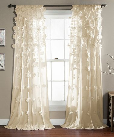 Ivory Riley Curtain Panel   Flowing layers and handmade bow details create a soft, delicate look, while a convenient rod pocket ensures easy installation.   Includes one panel 50'' W x 84'' H 100% polyester Drapes panels curtains sheers luxury other colors available shabby chic