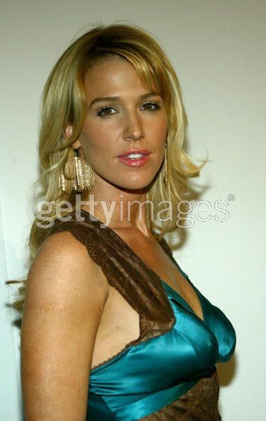 Ladies in Satin Blouses: poppy montgomery - teal satin top