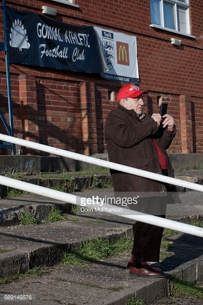 An elderly supporter of Wisbech Town taking a photograph on his... #wisbech: An elderly supporter of Wisbech Town taking a… #wisbech