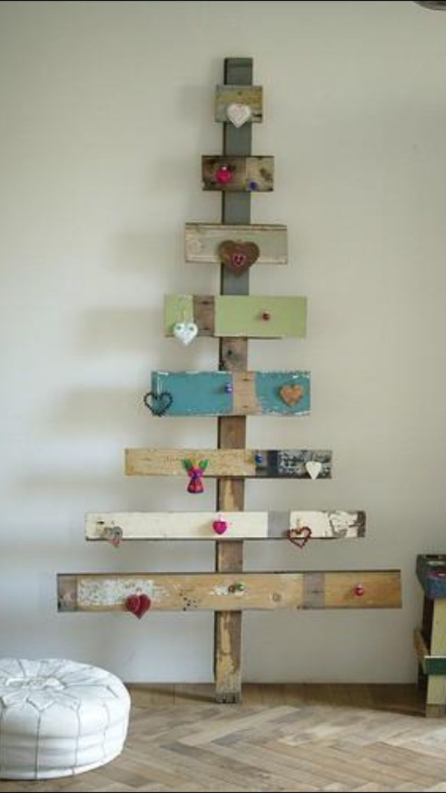 Paint it green, use cup hooks for hanging ornaments on it. Or use it for displaying cards.