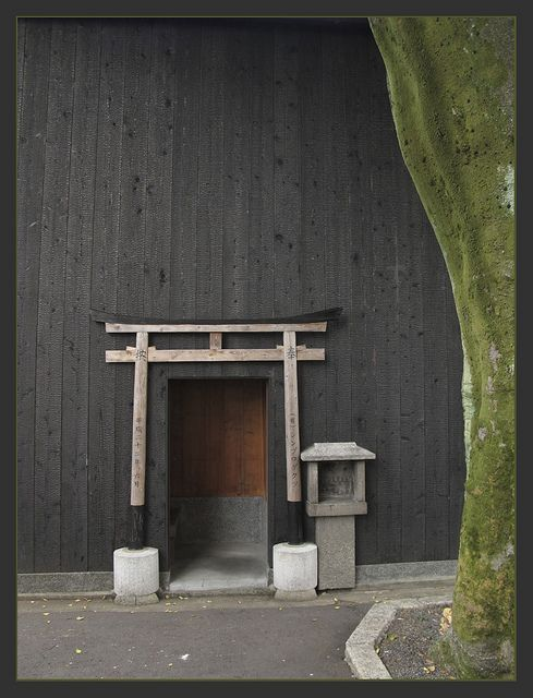 Small torii gate in Kyoto, Japan. It's a little pretentious, but gates are worth fussing over, because they heighten awareness of transitions.