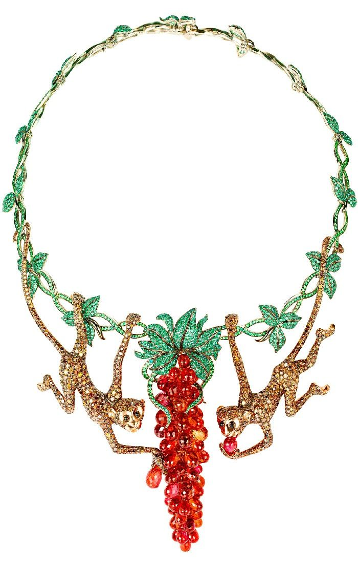 Necklace with a pair of monkeys in white & yellow gold set with emeralds, sapphires, tsavorites, onyx & brown diamonds.