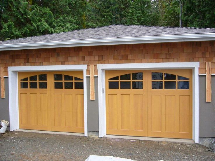 89 best images about clopay wood carriage house garage for Best wood for garage doors