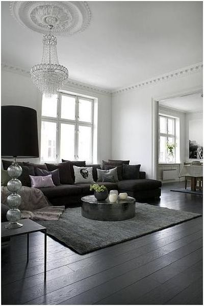Black and white living room. I looooove this! Looks like a cute older home and that chandelier is amazing!