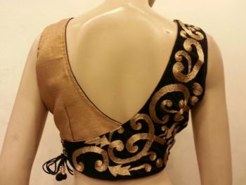 Stunning black velvet and golden blouse