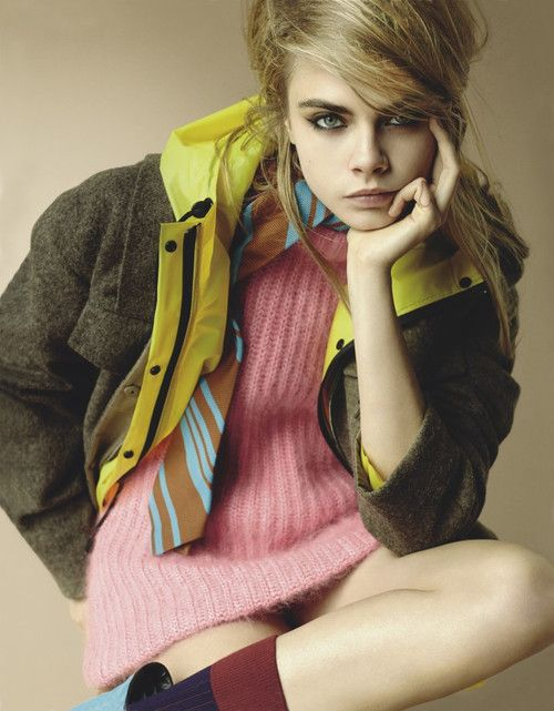 Cara Delevingne - Mario Testino - September 2014 issue  I like this photo because the colours are pastels but bright so they stand out from the background. The lighting adds a 70s/80s/90s feel to it.