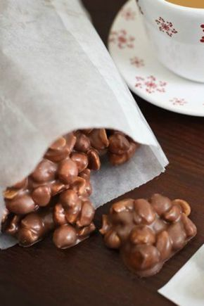 These tiny bundles of chocolate-peanut goodness would be great to give away as holiday gifts, or for a fun twist on the traditional Christmas cookie tray fare. All you need is four ingredients and 10 minutes of prep time; the slow cooker does the rest! Feel free to double the recipe if you have a large slow cooker.