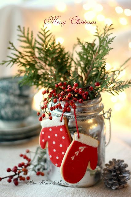 Festive Silver Mason Jar dressed with greens and decorated with red cookie mittens - such sweet red and white Christmas decorations