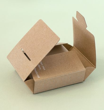 Natural look packaging for jewelry designer, shown open. Practical design folds from one piece to form finished box. phage