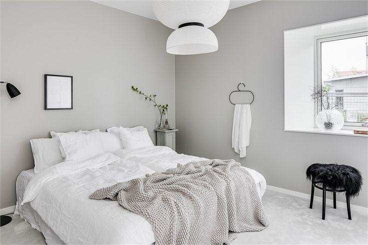 Beige, white & black bedroom