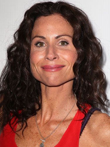Famous Actress Minnie Driver with her signature spirals curly hairdo.