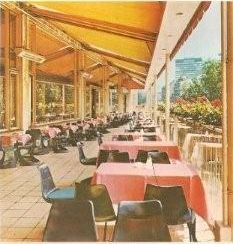 A Street Cafe and Restaurant with only Danish furniture designer Steen Ostergaard's cantilever injection molded 290 chairs! Where do you think this is?
