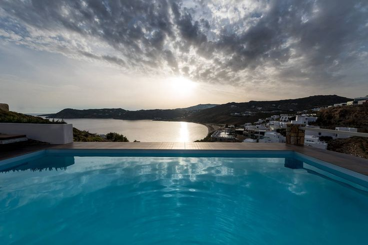 Apartment in Mikonos, Greece. MYKONOS SUITES Mykonos Suites is a new ultra-exclusive boutique hotel located in Elia, Mykonos, with stunning views of Elia and Agrari beach as well as Naxos & Paros islands. Sitting on an unspoiled cliff almost 150 meters from one of the most fam...