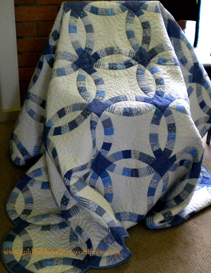 Blue and White Double Wedding Ring Quilt, hand pieced and hand quilted by Kay Smith.  Goldfields Quilters 2011 Raffle Quilt.