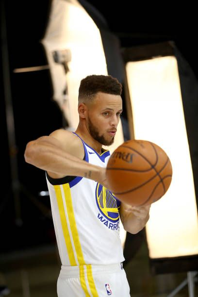 Stephen Curry of the Golden State Warriors poses for a portrait during a photo shoot during the Golden States Warriors media day at Rakuten...