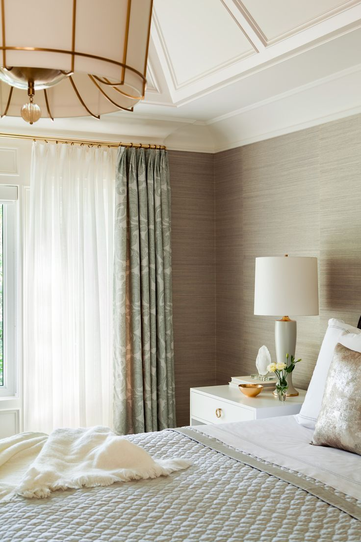 grasscloth wallpaper, brass curtain rods, statement chandelier, soothing neutrals