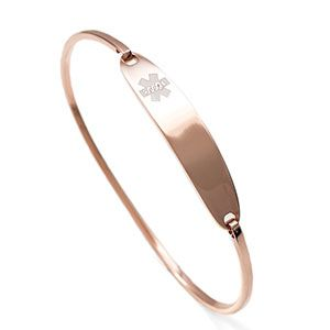 Rose gold medical alert bracelet.  Allows for laser or traditional etch engraving both front and back. Provides a great minimal look.