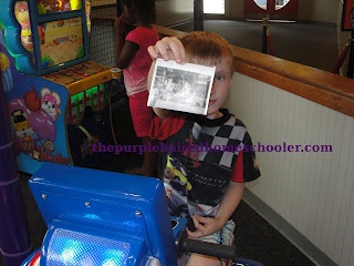 """My son loved getting his picture taken. """"Not only did he get to ride in a car with Chuck E., but he got a picture at the same time."""" -Beth: My Son"""