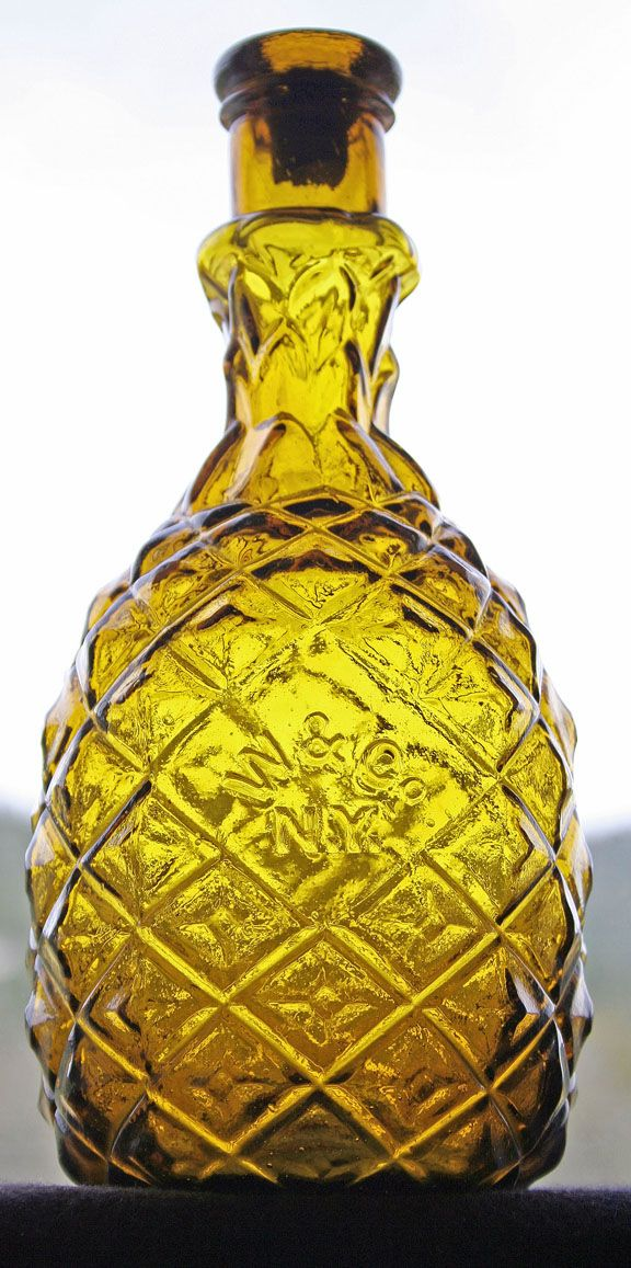 Antique pineapple shaped glass bottle.