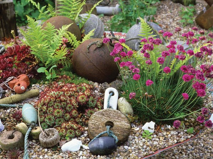 Boating, fishing and other nautical elements add delight and interest to a planting bed.