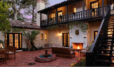 LOVE the Spanish courtyard - check out the fireplace and couch.