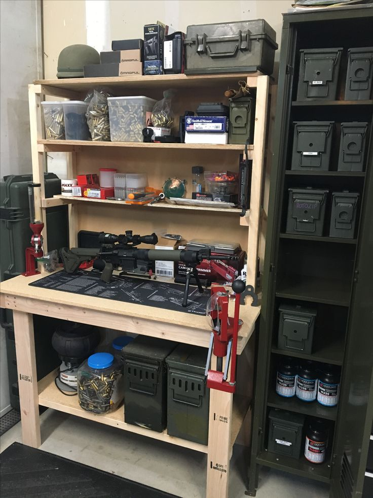 Reloading bench made from scrap wood and ammo storage locker