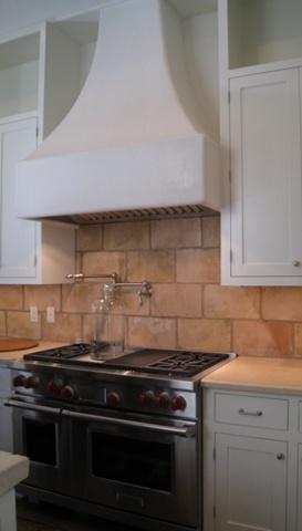 Plaster range hood. large tile for backsplash