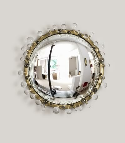 The appeal of a convex mirror is that they transform the room, while allowing themselves to be transformed.