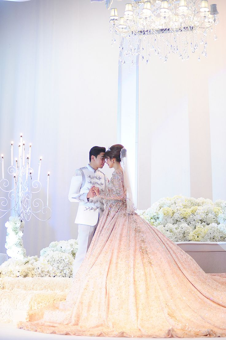 A holy matrimony of the prince and his princess in white and pink // Malaysian TV personalities Amar Baharin and Amyra Rosli tied the knot in a lavish nikah (solemnisation ceremony) in Kuala Lumpur, Malaysia. The bride wore a jaw-dropping bespoke blush ball gown made of French lace and Swarovski crystals, while the groom looked every part the knight in shining armour in his Prince Charming-inspired suit by Rizman Ruzaini Creations. Here, we take you inside this celebrity couple's fairytale…