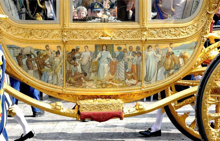 Afbeelding van slaven op de gouden koets
