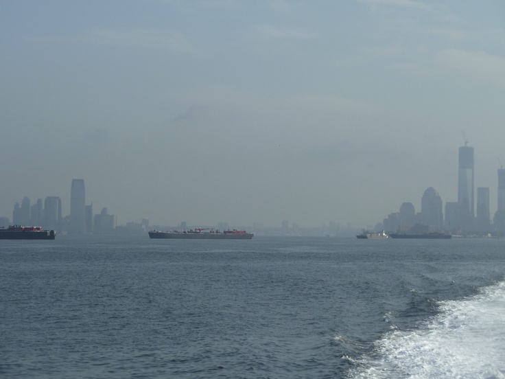 Lower Manhattan and New Jersey Skylines face the busy harbor...