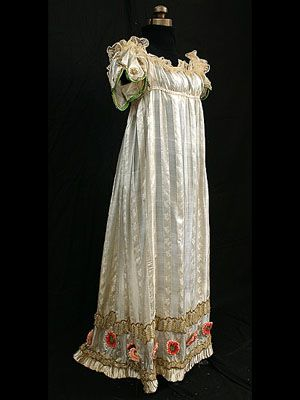 "Neoclassical silk evening dress with metallic trim, Ca.1800. I always thought that the Empire waistline was very practical when women were either pregnant or recovering from childbirth almost constantly.I shudder to think what corsets were like later- they even had ""pregnancy corsets""! The poor mothers & babies."