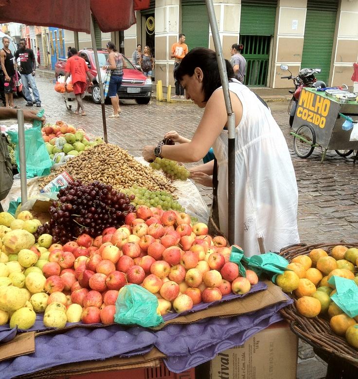 Bying fruits and peanuts.
