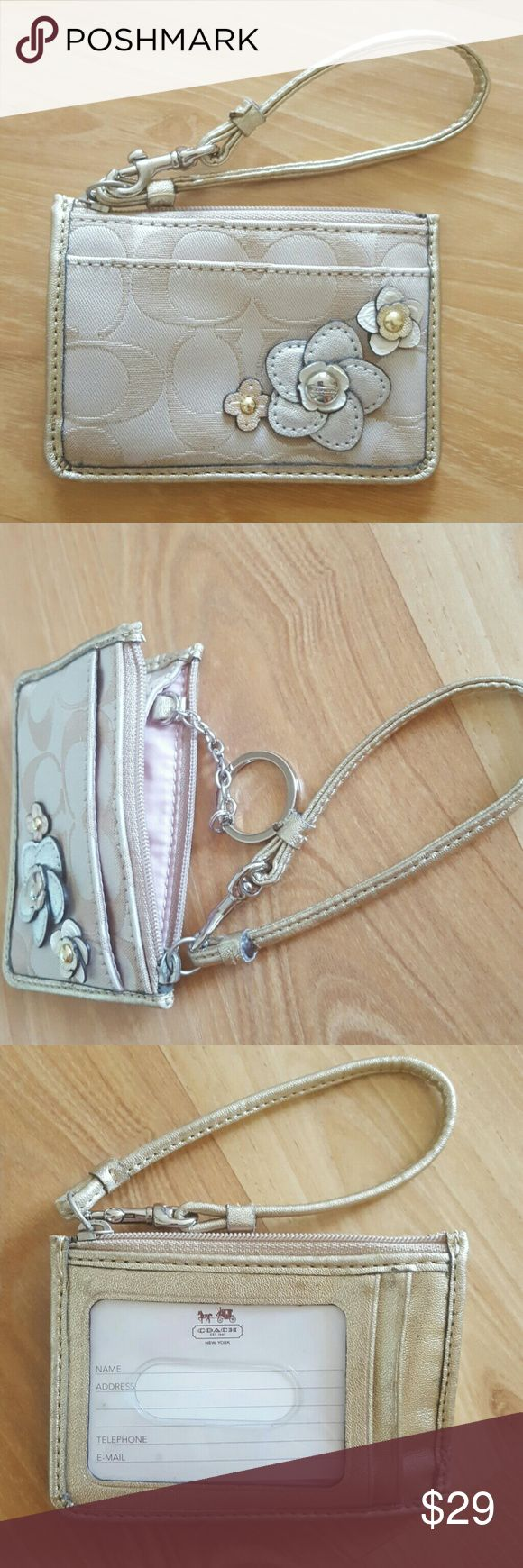 Coach coin pouch with key chain Perfect for a quick trip to the store or for travel. Easily access your ID & c-cards. Used less than a hand full of times. Leather of petal is lifting (see last photo), otherwise in great condition. Offers welcome. Coach Bags Wallets