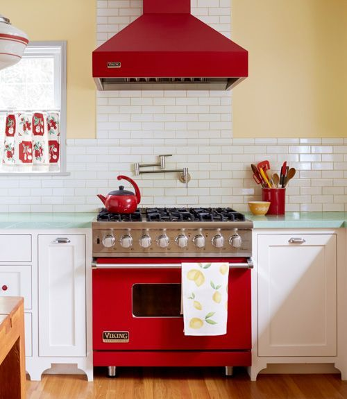 "With cheerful, red appliances and mint green granite countertops, white subway tile provides the perfect contrast in this retro-themed kitchen. | Don't want ""vintage theme"" but like the red.  
