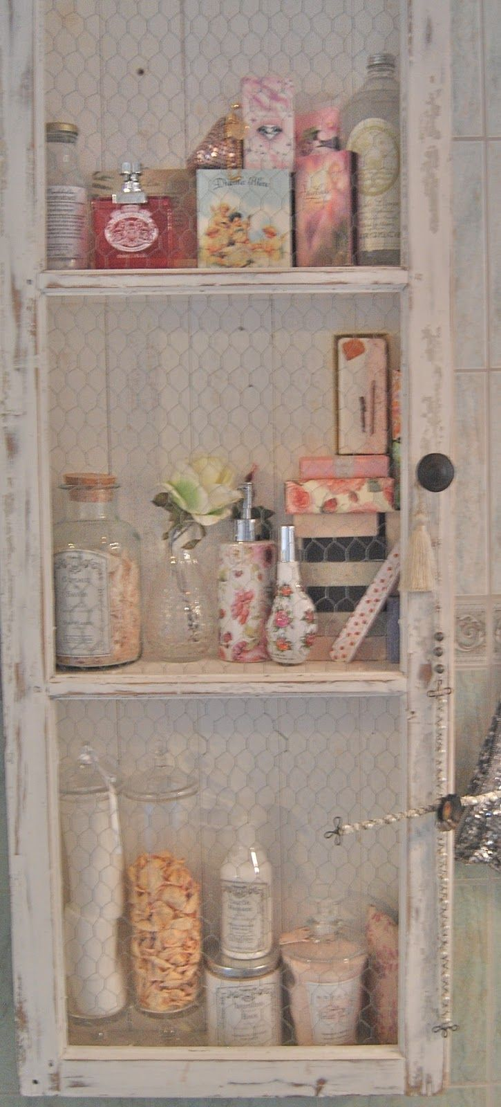 #chippypaint and chicken wire hold items needed for the bathroom in a guesthouse
