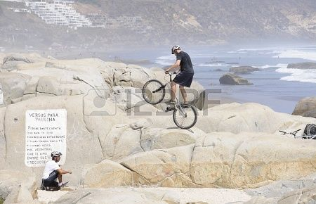 Cycling acrobatic on the rocks