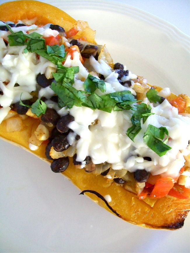 """Southwestern stuffed butternut squash---to make this a """"no processed foods"""" sort of dish, ditch the vegan cheese or add a homemade nutrtional yeast """"cheese"""" sauce."""
