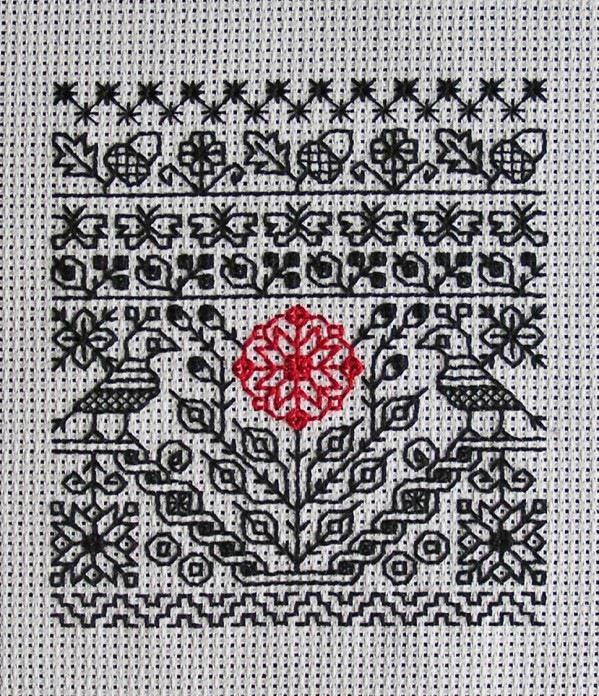 Blackwork with red accent