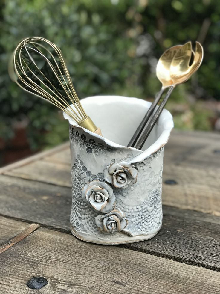 Large lacy utensil holder with three roses