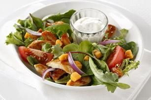 BBQ Ranch Chicken Salad recipe - You can't tell by looking and you certainly can't tell by tasting, but this salad made with savory chicken, Cheddar cheese and a drizzle of ranch dressing is low-cal.