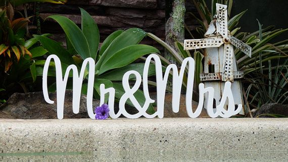Mr and Mrs free standing wedding signs. Make your own unique table decorations and centrepieces with my stunning Mr and Mrs wooden wedding signs. White is the most popular choice for wedding signs, however feel free to contact me if you would like another colour than the ones I have listed. If you like a little bling I have silver, white and gold glitter that will add the perfect sparkle to your wooden wedding name.   * Mr&Mrs wooden wedding sign in bliss font  * Choose either 15cm x 18cm...