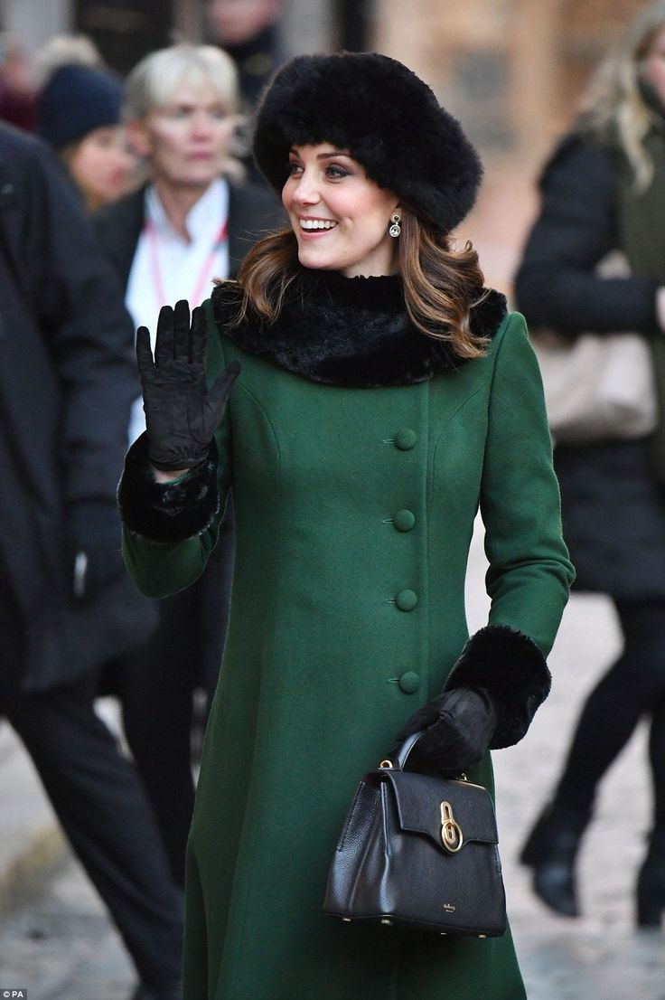 The pregnant Duchess looked glowing, wrapped up against the cold in a green coat by Catherine Walker