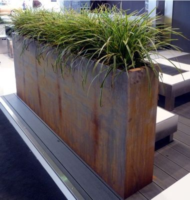Outdoor Corten steel planter provides privacy and art for landscaped gardens