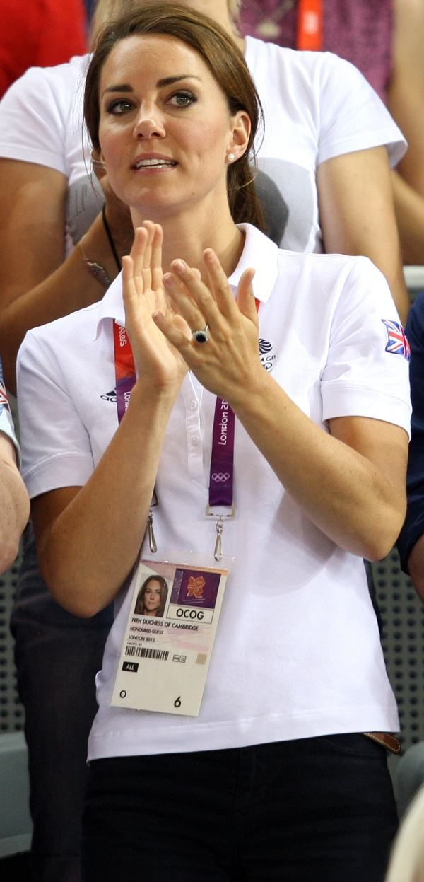 Duchess Catherine wore her Team GB polo shirt J Brnad jeans, pearl earrings and wore her hair in a ponytail.