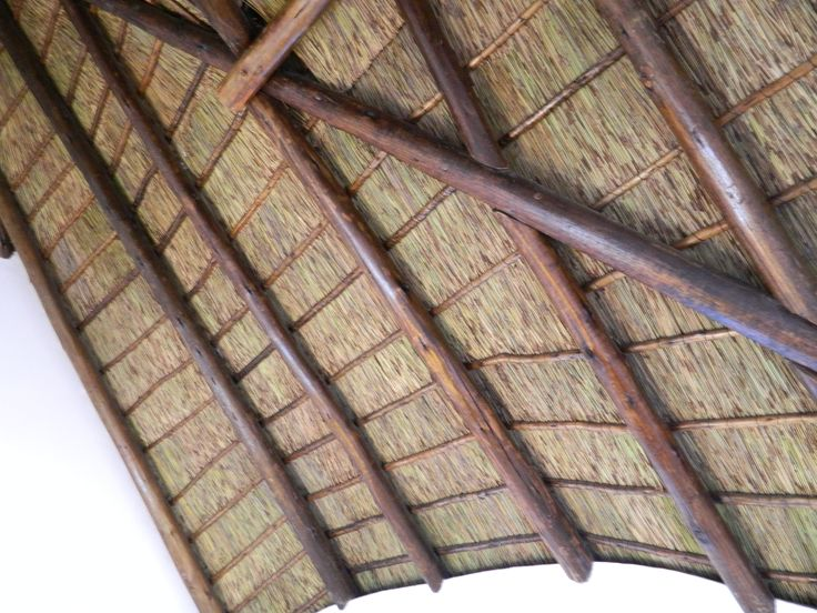 A great effect for our thatch roof conversions is that you can keep the look of a thatched roof on the inside - we use a thin layer of thatch underneath the branderings and tiles so your house can keep the homely, comforting aesthetic of thatch inside
