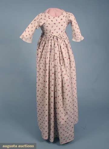 "PRINTED COTTON ROUND GOWN, ENGLISH, c. 1800  Lot: 120 April 2009 Vintage Fashion and Textile Auction New York City White ground printed w/ small scattered red, pink, purple & blue leaves & flowers, gathered 4 band drop front bodice w/ shoulder buttons, center back ties, short tucked sleeves trimmed w/ lace, pair blue threads in selvedge, linen bodice & sleeve linings, B 30""-34"", W Adjustable, L 51""-55"", (period mend under arm) excellent.                    Price Realized: $ 900.00"