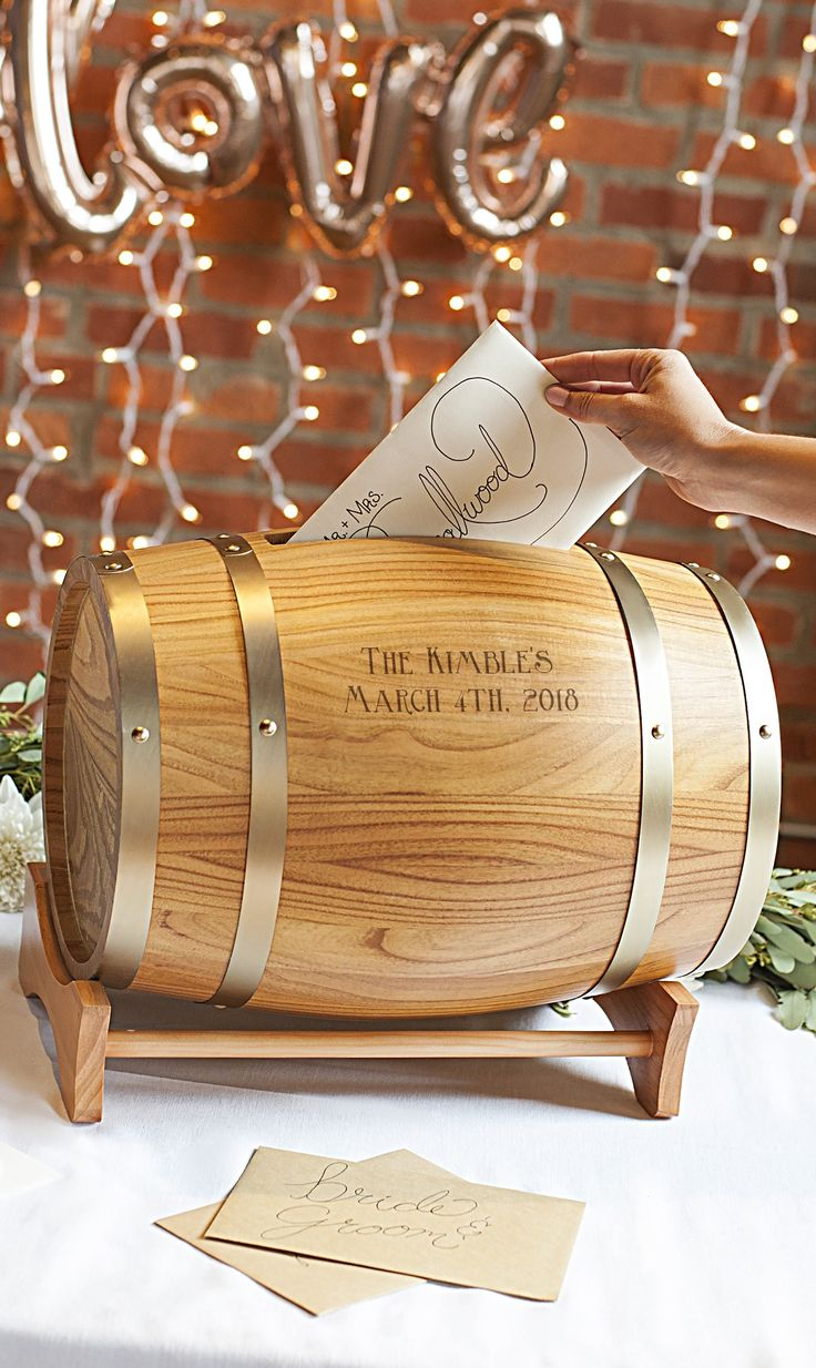 A unique wedding couple gift and keepsake, this miniature wood wine barrel personalized with the bride and groom's name, monogram or married name initial and wedding date is an attractive way to hold gift cards at the wedding reception. Guests drop their gift card in the slot. Later, the bride and groom can remove the knobbed barrel end to remove the cards. This gift card holder can be purchased at http://myweddingreceptionideas.com/personalized-wood-wine-barrel-gift-cards-holder.asp