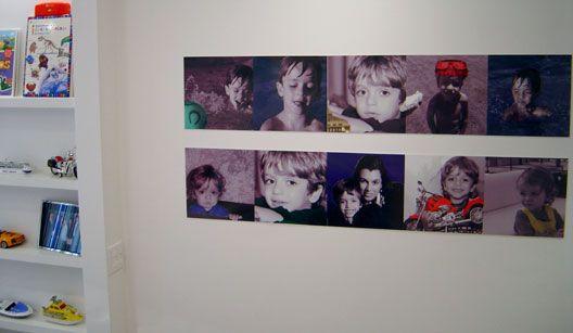 A escolha das arquitetas para alegrar o ambiente foi adesivar a parede branca com fotos especiais.