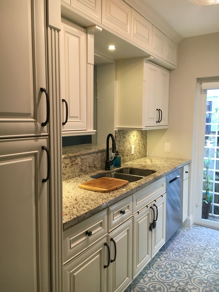 Small galley kitchen gets upgrade with Cuban tropical tile, new impact door, refurbished cabinets and low profile Samsung appliances